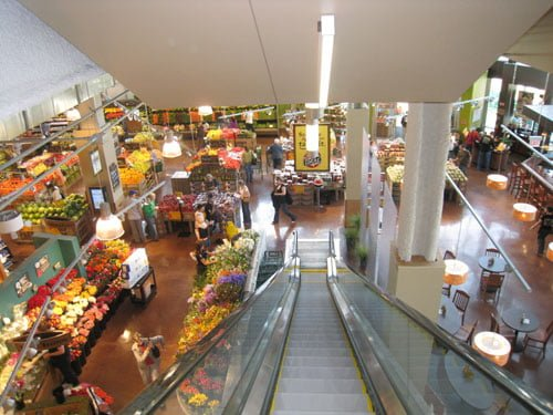 View of the produce section, flower area, and bar from the escalators coming from the parking garage.